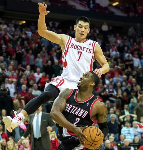 Guard Jeremy Lin tries to stop a drive by the Blazers' Wesley Matthews during the fourth quarter, when the Rockets used Lin as part of a small lineup. Photo: Smiley N. Pool, Staff / © 2014  Houston Chronicle