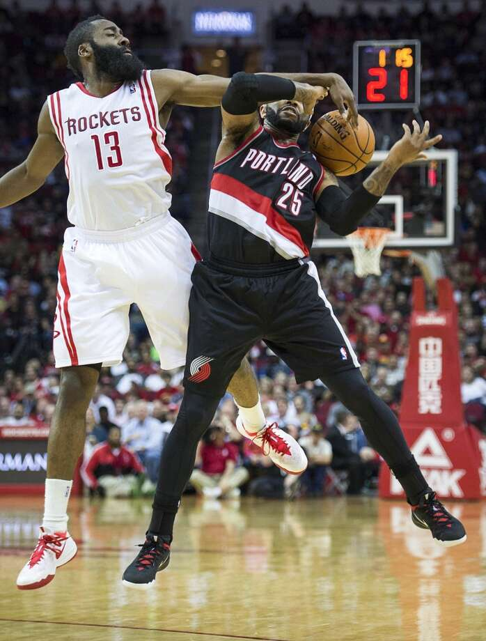 March 9: Rockets 118, Trail Blazers 113 (OT) Rockets guard James Harden knocks the ball away from Trail Blazers point guard Mo Williams. Photo: Smiley N. Pool, Houston Chronicle