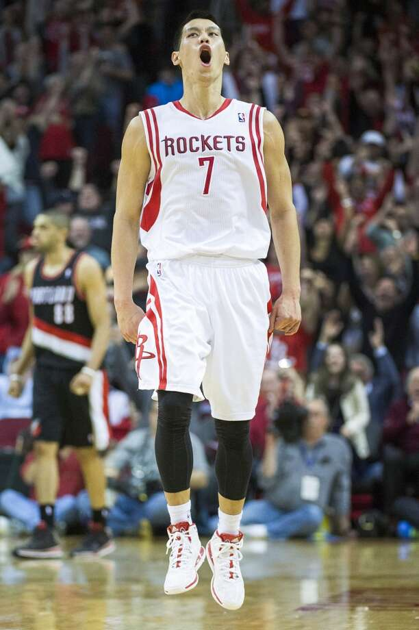Rockets point guard Jeremy Lin celebrates after hitting a 3-pointer to give the Rockets a 102-101 lead with 1:26 left in the game. Photo: Smiley N. Pool, Houston Chronicle