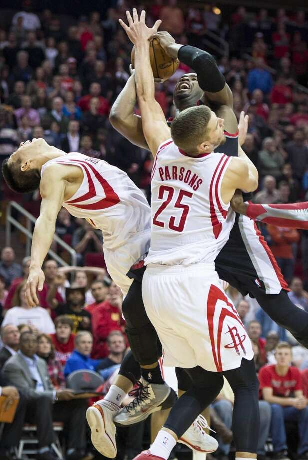 Rockets guard Jeremy Lin (7) and forward Chandler Parsons (25) defend against Trail Blazers shooting guard Wesley Matthews. Photo: Smiley N. Pool, Houston Chronicle
