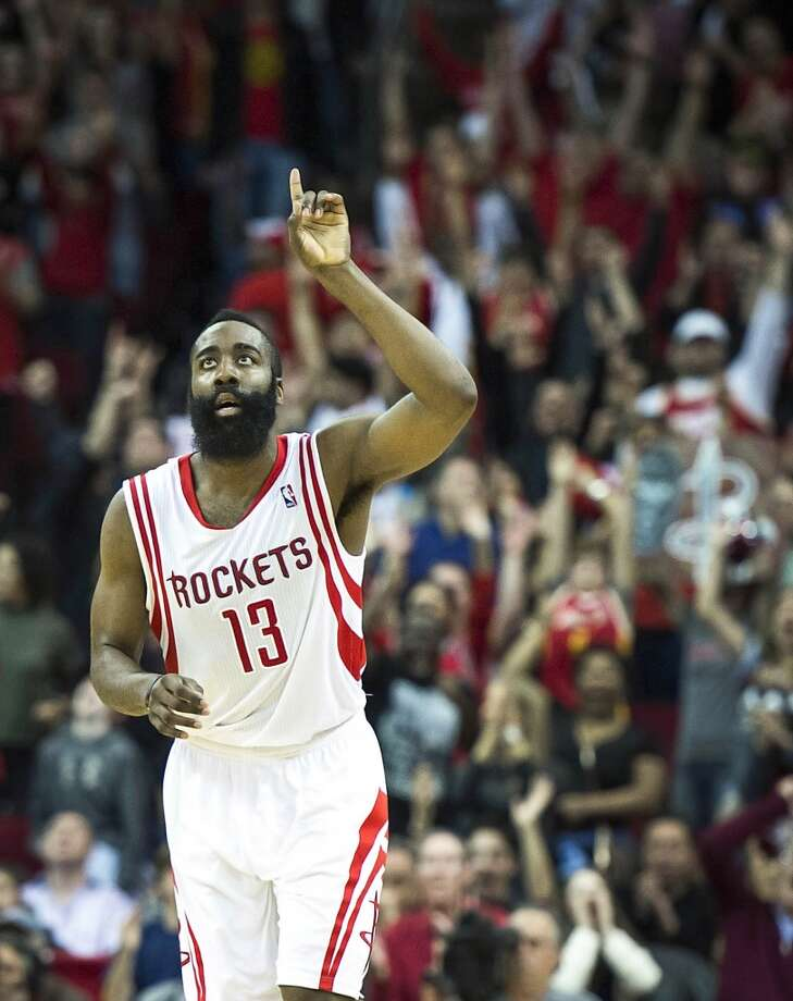 Rockets guard James Harden celebrates after hitting a 3-pointer to give him 41 points in the game and tie the score at 113-113 during overtime. Photo: Smiley N. Pool, Houston Chronicle