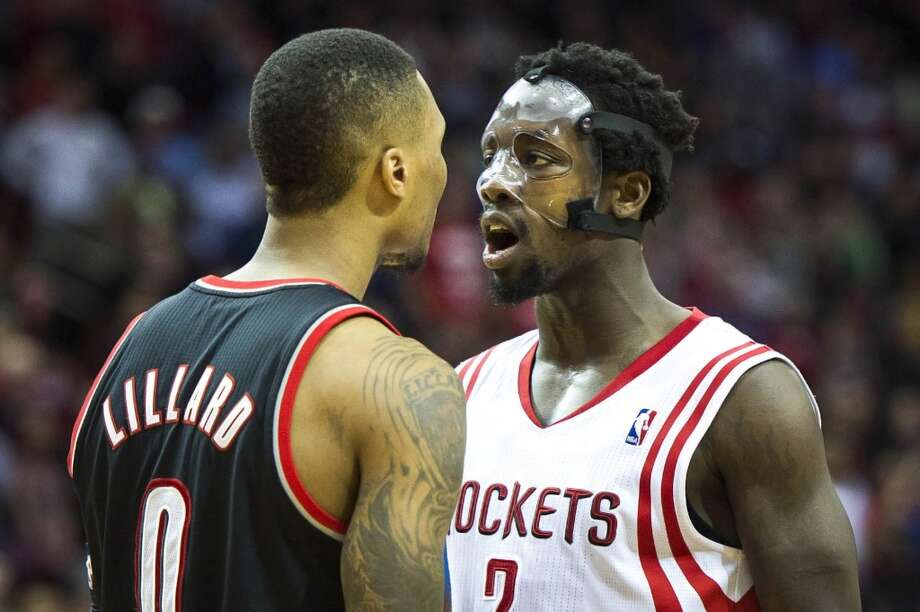 Rockets point guard Patrick Beverley has words with Trail Blazers point guard Damian Lillard. Photo: Smiley N. Pool, Houston Chronicle