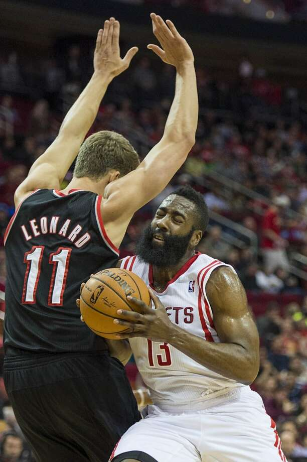 Rockets guard James Harden collides with Trail Blazers center Meyers Leonard. Photo: Smiley N. Pool, Houston Chronicle