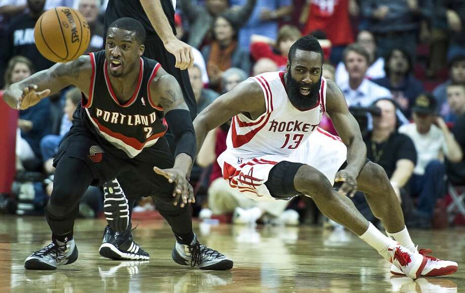 Rockets guard James Harden fights for a loose ball against Trail Blazers shooting guard Wesley Matthews during overtime. Photo: Smiley N. Pool, Houston Chronicle