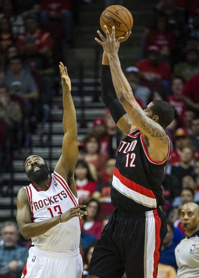 Trail Blazers power forward LaMarcus Aldridge shoots over Rockets shooting guard James Harden. Photo: Smiley N. Pool, Houston Chronicle