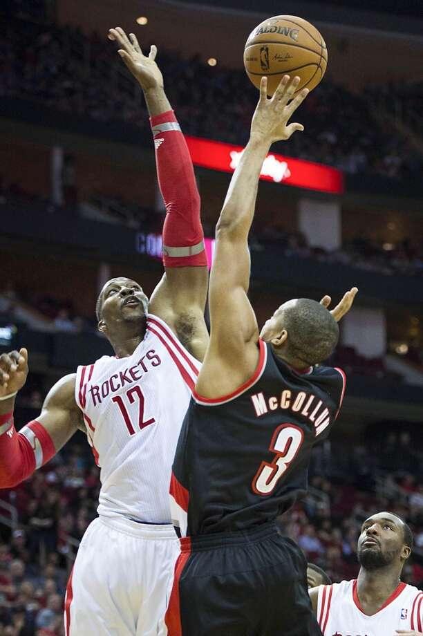 Rockets center Dwight Howard (blocks a shot by Trail Blazers shooting guard C.J. McCollum. Photo: Smiley N. Pool, Houston Chronicle