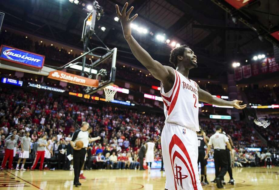Rockets point guard Patrick Beverley gestures to the crowd during the fourth quarter. Photo: Smiley N. Pool, Houston Chronicle