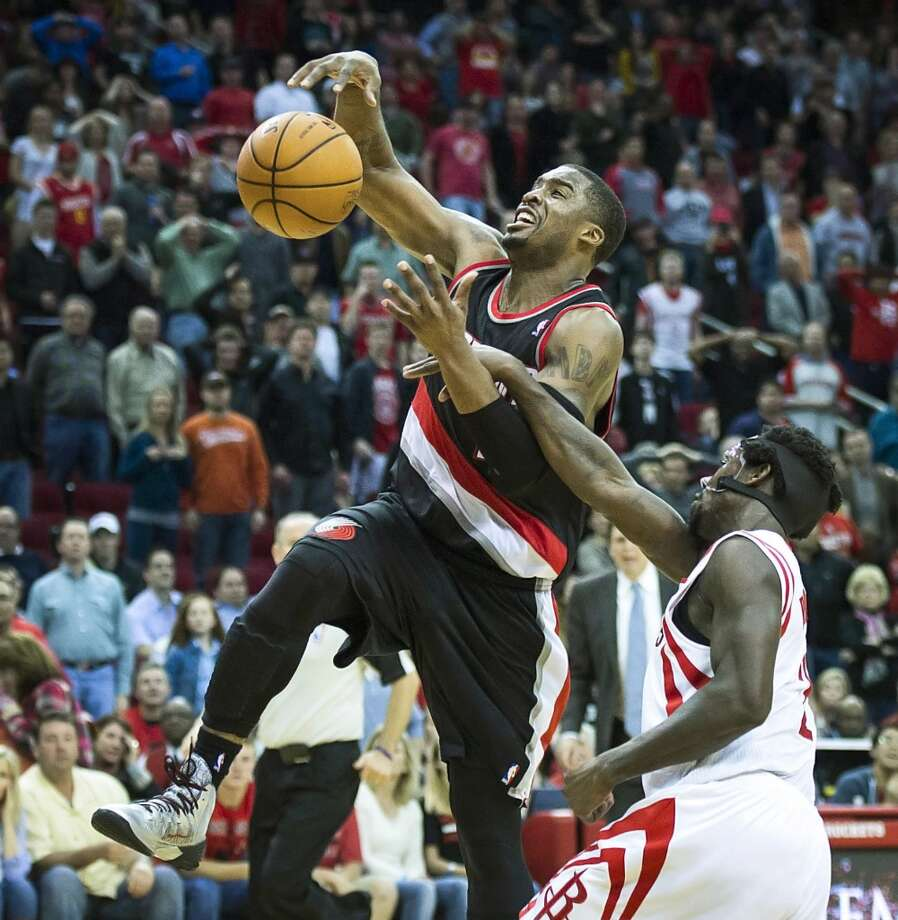 Rockets point guard Patrick Beverley fouls Trail Blazers shooting guard Wesley Matthews during overtime. Photo: Smiley N. Pool, Houston Chronicle
