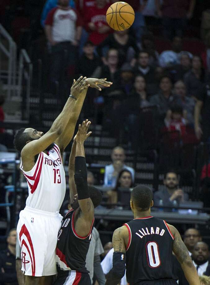 Rockets shooting guard James Harden hits a 3-pointer over Trail Blazers shooting guard Wesley Matthews with 8.8 seconds left to play to tie the game and force overtime. Photo: Smiley N. Pool, Houston Chronicle