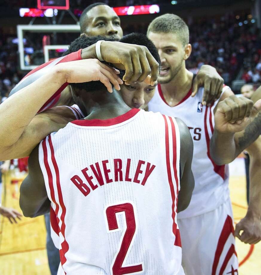 Rockets point guard Jeremy Lin celebrates with Patrick Beverley, Dwight Howard and forward Chandler Parsons after a victory over the Trail Blazers. Photo: Smiley N. Pool, Houston Chronicle