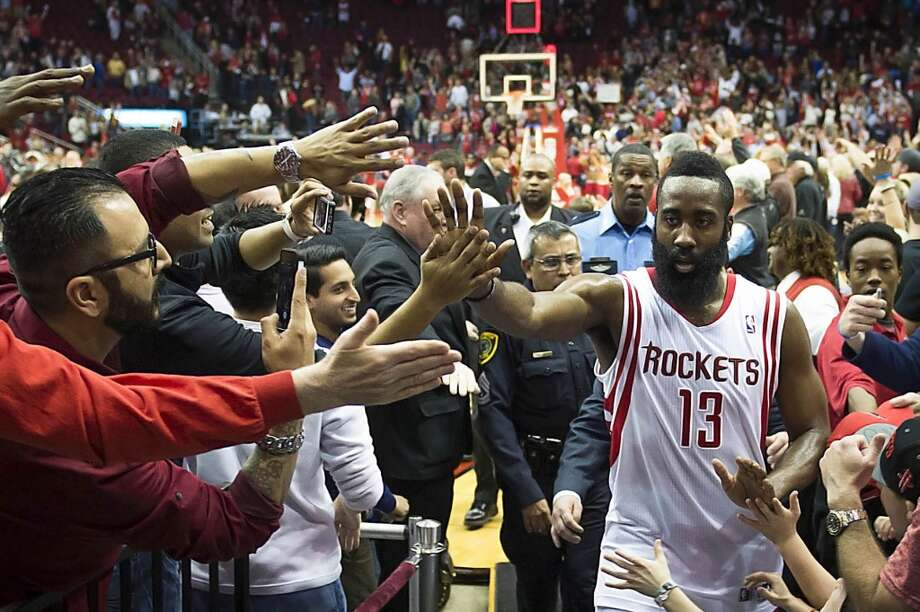 Rockets shooting guard James Harden celebrates with fans after a victory over the Trail Blazers. Photo: Smiley N. Pool, Houston Chronicle