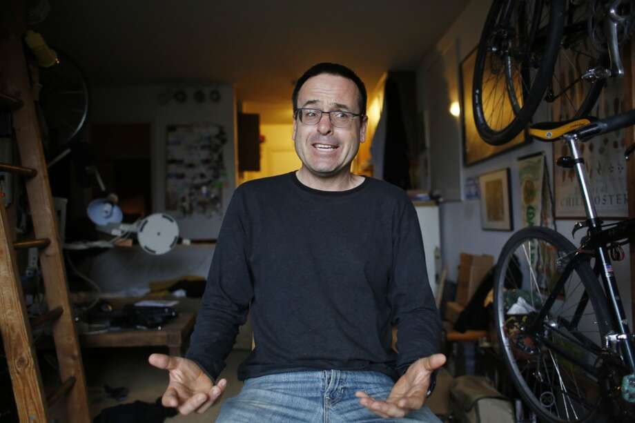 Sitting in his studio apartment in Noe Valley, computer repairman and general tinkerer of all things mechanical Mike Wyatt, talks about his love of figuring out way to fix things. Photo: The Chronicle
