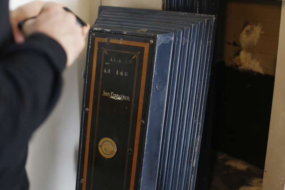 Mike Wyatt takes a picture of the safe he opened in a garage in the Upper Castro neighborhood of San Francisco. Photo: The Chronicle