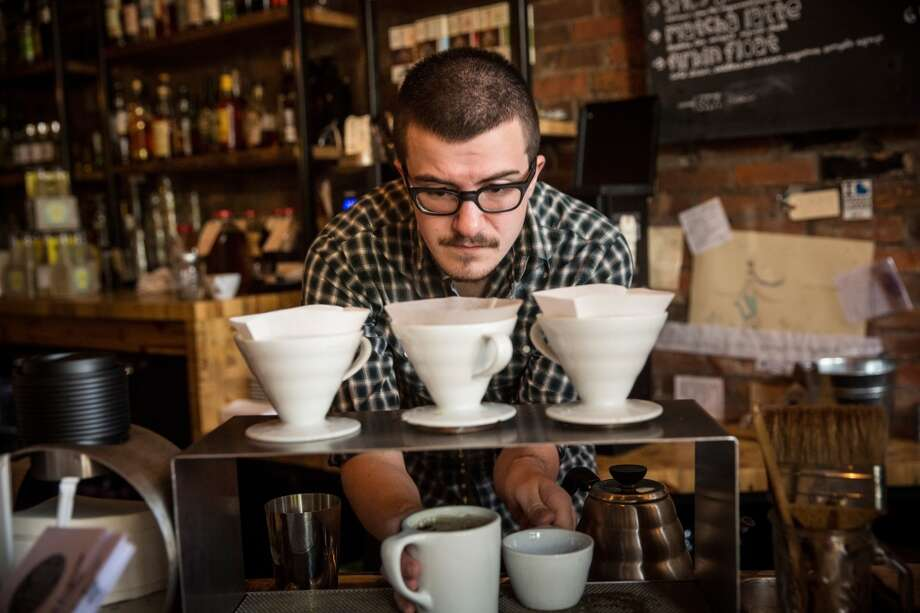 This is your typical hipster. That's not exactly what you'll find in Seattle anymore, though.  (The coffee is still accurate.) Photo: Andrew Burton, Getty Images