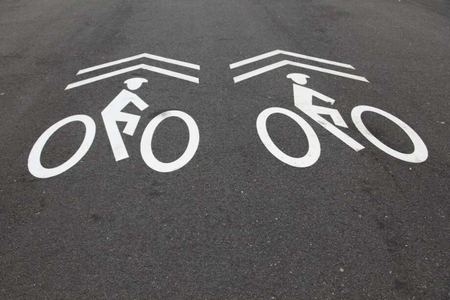 "Bike lanes have appeared. Points if they have sharrows and bike figures with helmets. More points if anyone in the neighborhood actually uses the word ""sharrow"" in a sentence. Photo: Wendy Connett, Getty Images/Flickr RF"