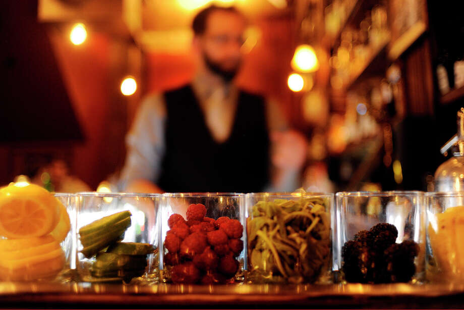 """Neighborhood dive bars have disappeared, and """"mixologists"""" with tidy black vests and craft cocktails have moved in. Photo: AARON ONTIVEROZ, DP / (C) 2012 The Denver Post, MediaNews Group"""