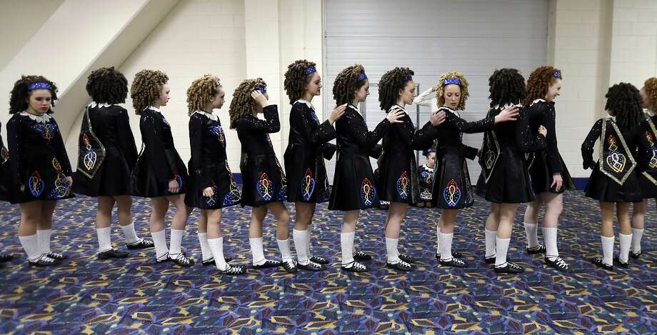 Students from Rebecca McCarthy School of Dance prepare for their performance before the quarterfinals of the Big East women's basketball tournament in Rosemont, Ill., Sunday, March 9, 2014. The students will perform at halftime. (AP Photo/Nam Y. Huh) Photo: Nam Y. Huh, Associated Press