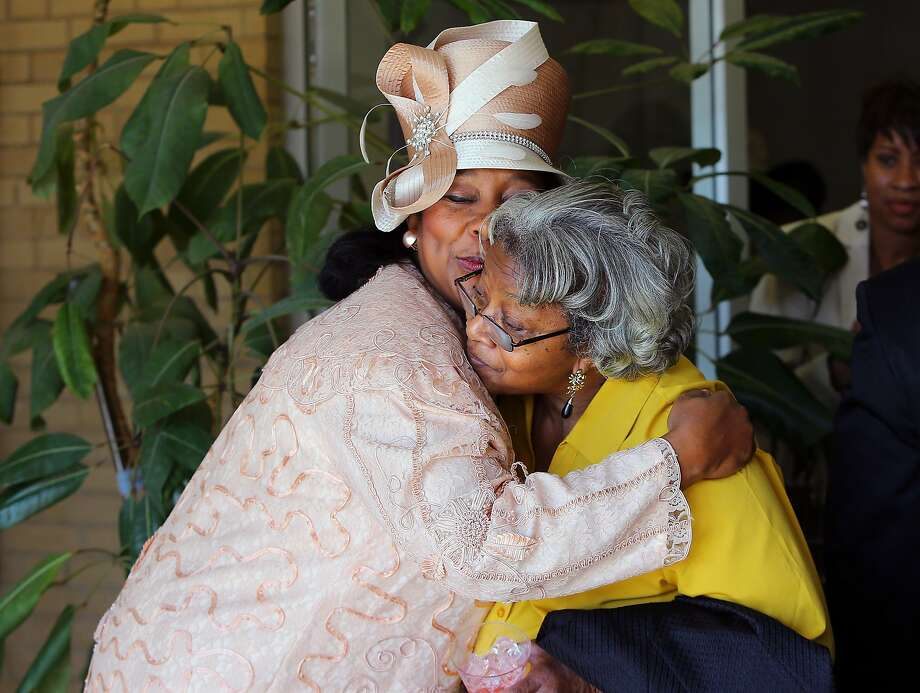 Mount Vernon Baptist Church member Lanet Stanley-Turner, left, hugs and Edna Andrews after their final worship service on Sunday, March 9, 2014, in Atlanta. It was the last time members will gather at the church to make room for the Falcons new stadium. (AP Photo/Atlanta Journal-Constitution, Curtis Compton)  MARIETTA DAILY OUT; GWINNETT DAILY POST OUT; LOCAL TV OUT; WXIA-TV OUT; WGCL-TV OUT Photo: Curtis Compton, Associated Press