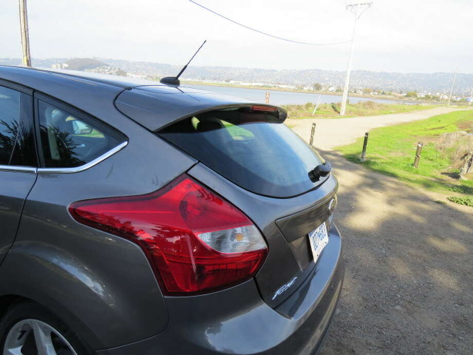 The intriguing style thing about the Focus hatch (there's also a sedan) is the way the rear portion of the roof flow gently down to a wing that shades the back window. It's a design feature that helps deflect wind, rain and dust from the backlight, but also looks kind of racy.