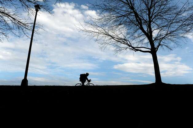 A bicyclist rides along the bike path on a warm Sunday afternoon, March 10, 2013 in Albany, NY.   (Paul Buckowski / Times Union) Photo: Paul Buckowski