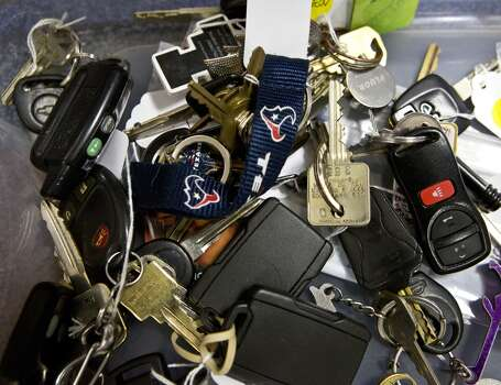 Sets of keys stored in bins at the lost and found at Reliant Center room 102. Saturday, March 8, 2014. ( Marie D. De Jesus / Houston Chronicle ) Photo: Marie D. De Jesus, Houston Chronicle