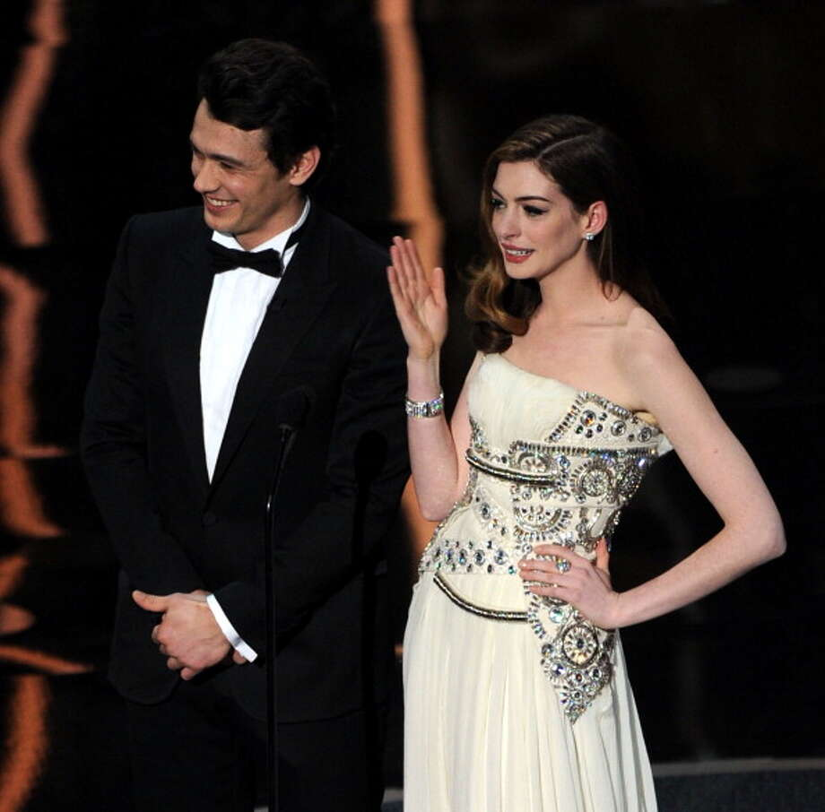 HOLLYWOOD, CA - FEBRUARY 27:  Hosts James Franco and Anne Hathaway speak onstage during the 83rd Annual Academy Awards held at the Kodak Theatre on February 27, 2011 in Hollywood, California.  (Photo by Kevin Winter/Getty Images) Photo: Kevin Winter, Getty Images / 2011 Getty Images