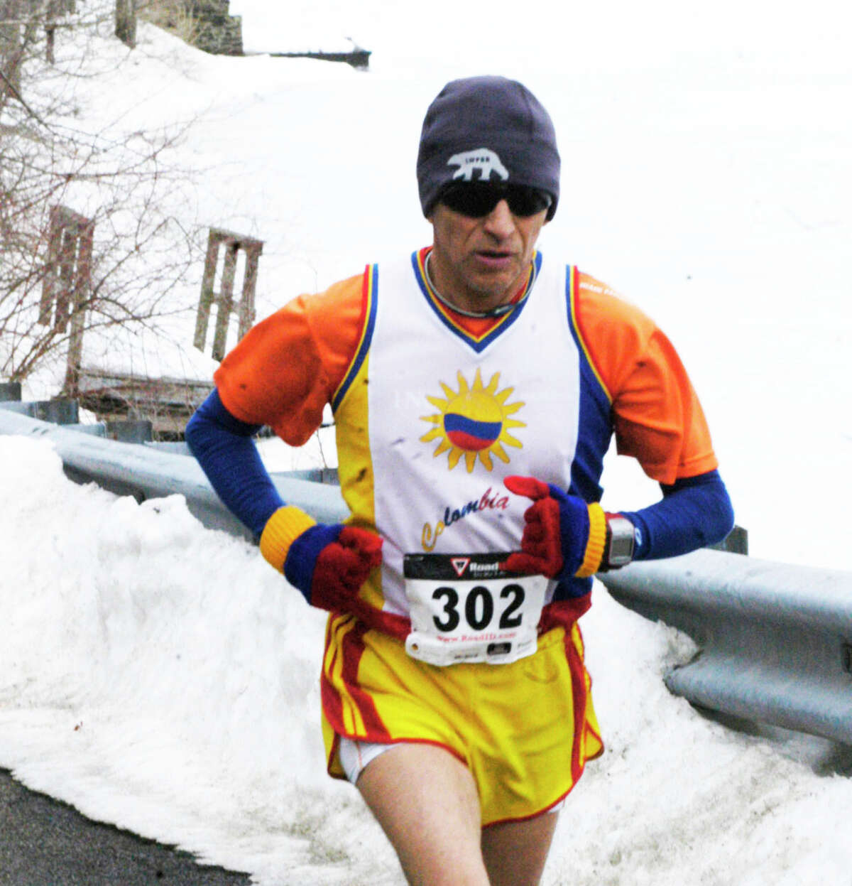 Seemingly ageless at 60, Pedro Cobos of New Milford maintains a steady stride as he nears the three-mile mark of the 30th edition of the Polar Bear Run around Lake Waramaug, Feb. 23, 2014.