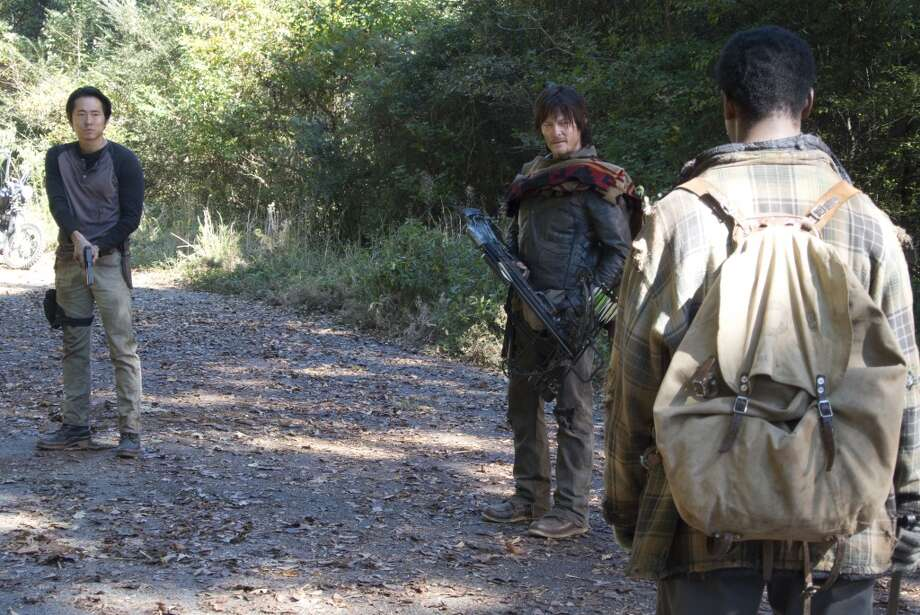 Glenn (Steven Yeun), Daryl Dixon (Norman Reedus) and Bob Stookey (Larry Gilliard Jr.) - The Walking Dead _ Season 4, Episode 13 - Photo Credit: Gene Page/AMC Photo: Gene Page/AMC