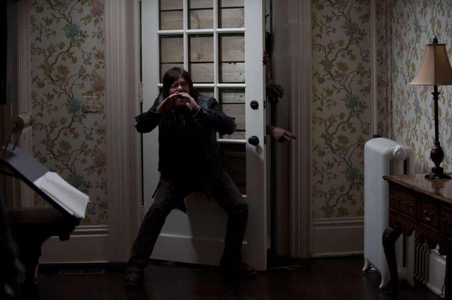 Daryl Dixon (Norman Reedus) and Walker - The Walking Dead _ Season 4, Episode 13 - Photo Credit: Gene Page/AMC Photo: Gene Page/AMC