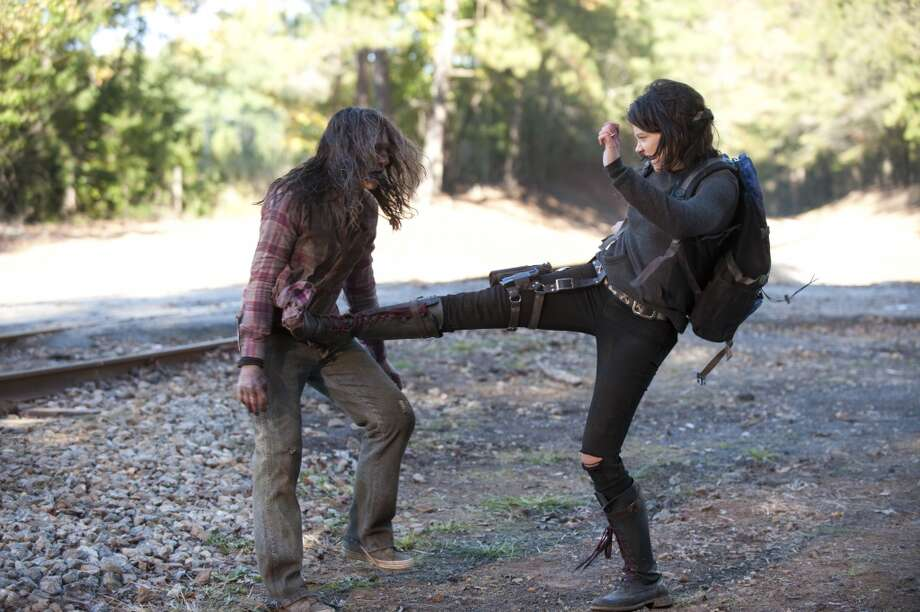 Walker and Maggie Greene (Lauren Cohan) - The Walking Dead _ Season 4, Episode 13 - Photo Credit: Gene Page/AMC Photo: Gene Page/AMC