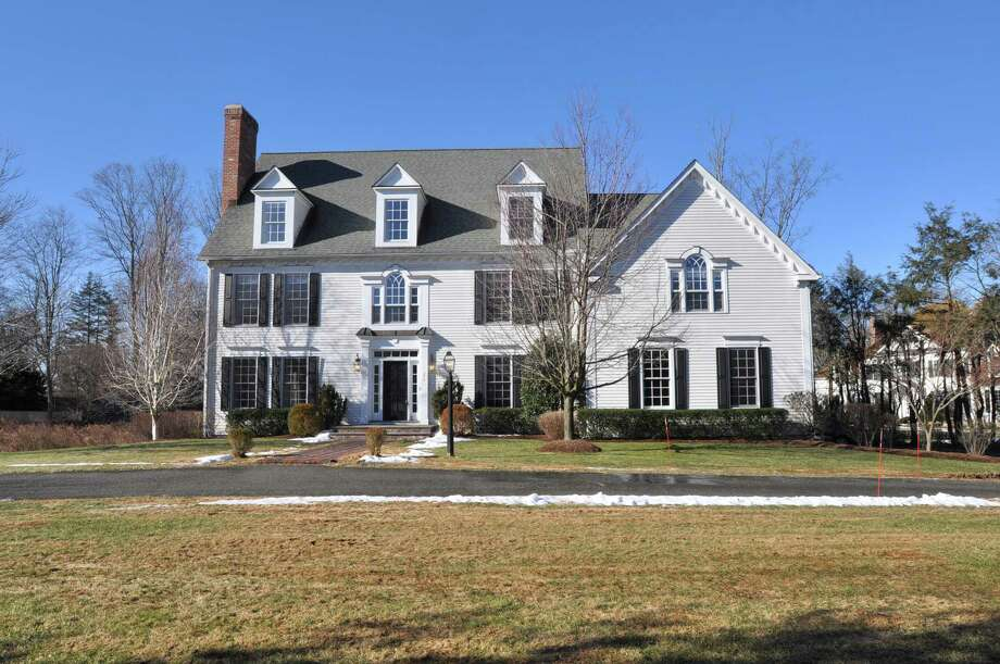 The Colonial at 277 Old Stamford Road in New Canaan has 15 rooms and four fireplaces on more than an acre of property. It is on the market for $2,550,000. Photo: Contributed Photo, Contributed / New Canaan News Contributed