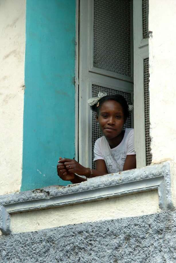 City life in Cap-Haitien is kinder to some, than to others. Photo: Christian Abraham / Connecticut Post