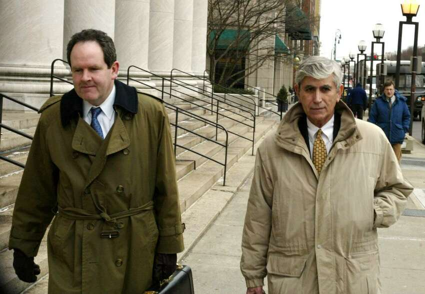 William Dow and David Grudberg, members of a New Haven law firm who are defending Perlitz, leave the New Haven Federal Courthouse on Feb. 2, 2010.