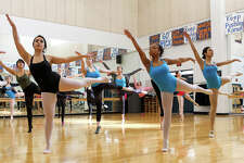 Members of the Brandeis Ballet Company, under the direction of Jacqueline Aguirre, warm up with centre work in their dance studio at Brandeis High School  on Thursday, March 6, 2014.  MARVIN PFEIFFER/ mpfeiffer@express-news.net