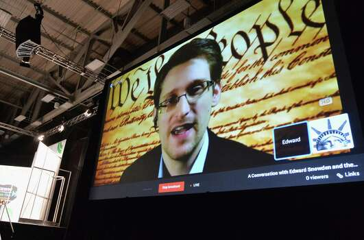"AUSTIN, TX - MARCH 10:  NSA whistleblower Edward Snowden speaks via videoconference at the ""Virtual Conversation With Edward Snowden"" during the 2014 SXSW Music, Film + Interactive Festival at the Austin Convention Center on March 10, 2014 in Austin, Texas.  (Photo by Michael Buckner/Getty Images for SXSW) Photo: Michael Buckner / 2014 Getty Images"