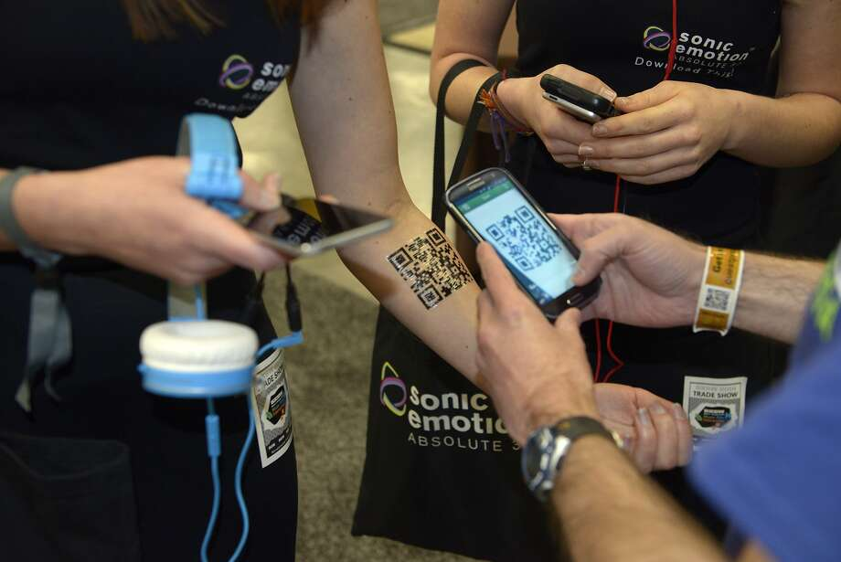 An app is downloaded via a tattoo at SxSW Interactive. Photo: Stephen Mclaren