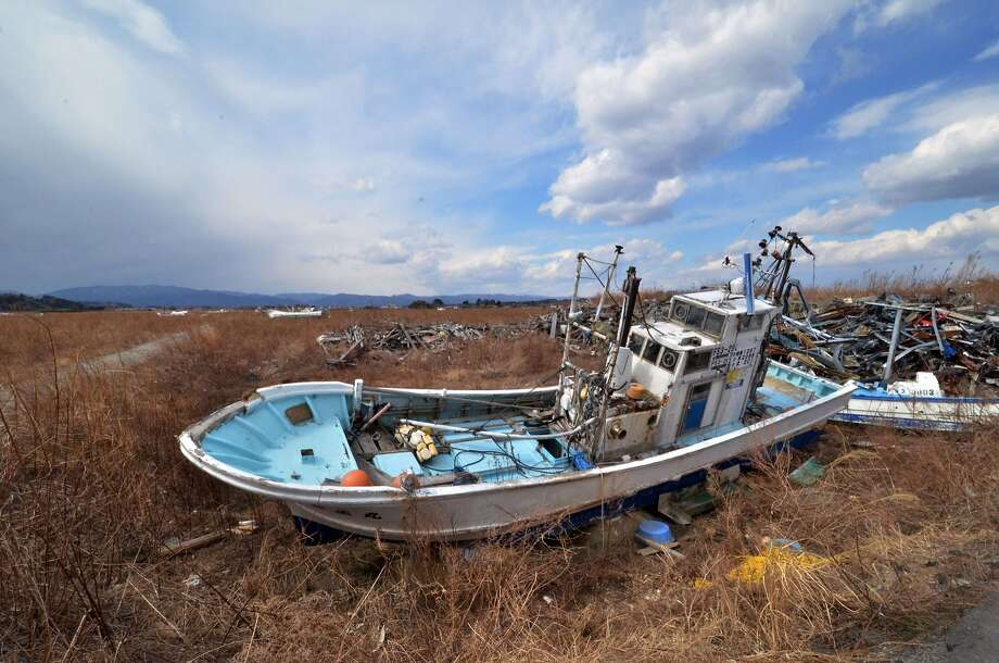 Boat graveyard:An abandoned fishing boat in Namie, Japan, sits in a field near the stricken Fukushima 