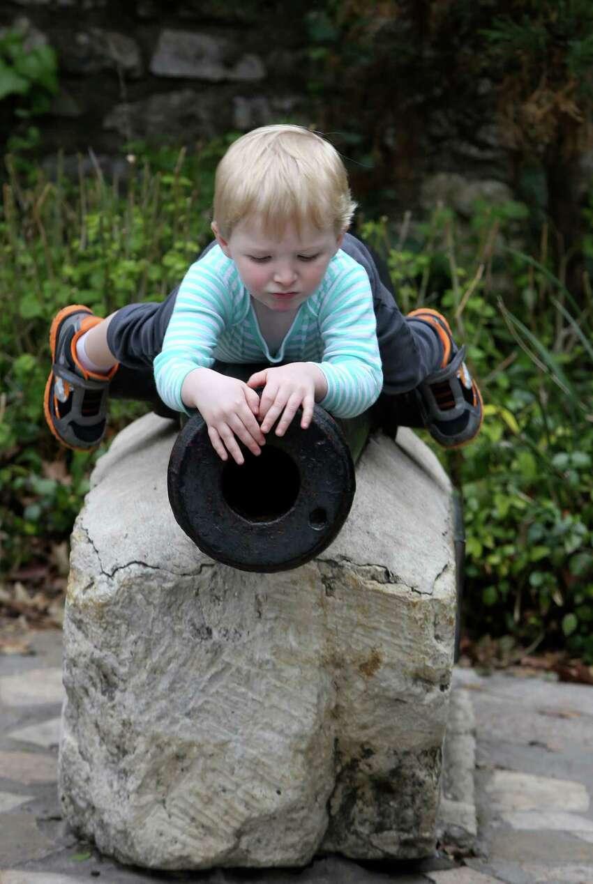 Timmy Brackett, 2, inspects one of the canons on the grounds of the Alamo. Brackett and his family were among the many spring breakers visiting the shrine on the first day of the week long school holiday.