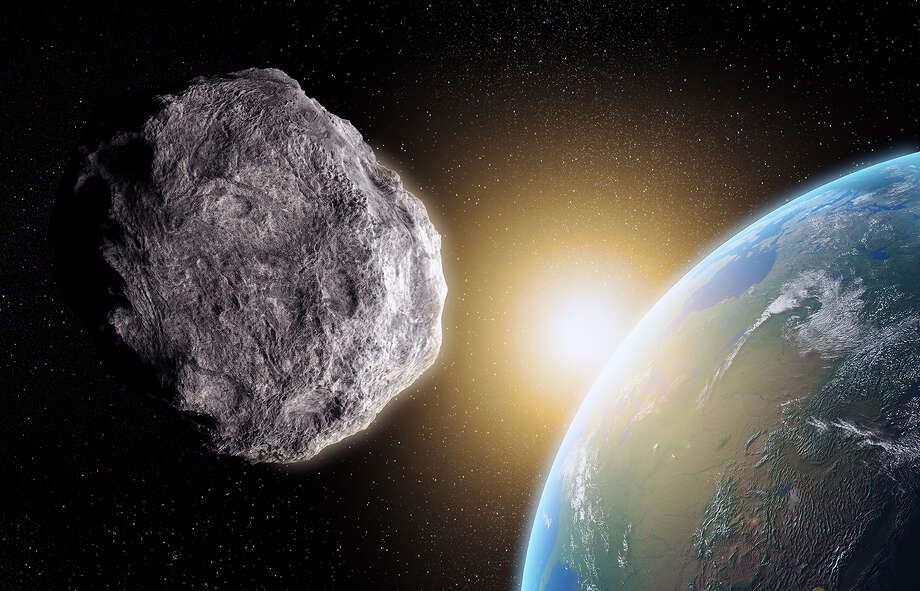Near Miss Day: Celebrated on March 23, the anniversary of a huge asteroid narrowly missing the earth in 1989 (well, by 500,000 miles - twice the distance to the Moon). 4581 Asclepius, around 300m in diameter, passed through the exact place that the Earth had been only six hours earlier. Scientists have estimated that a collision with an asteroid of this size would have released energy comparable to a 600 megaton nuclear weapon. Photo: Science Photo Library - ANDRZEJ WOJCICKI, Getty Images / Brand X