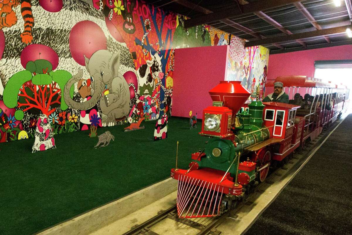 The Hermann Park train drives through the new art tunnel. ( J. Patric Schneider / For the Chronicle )