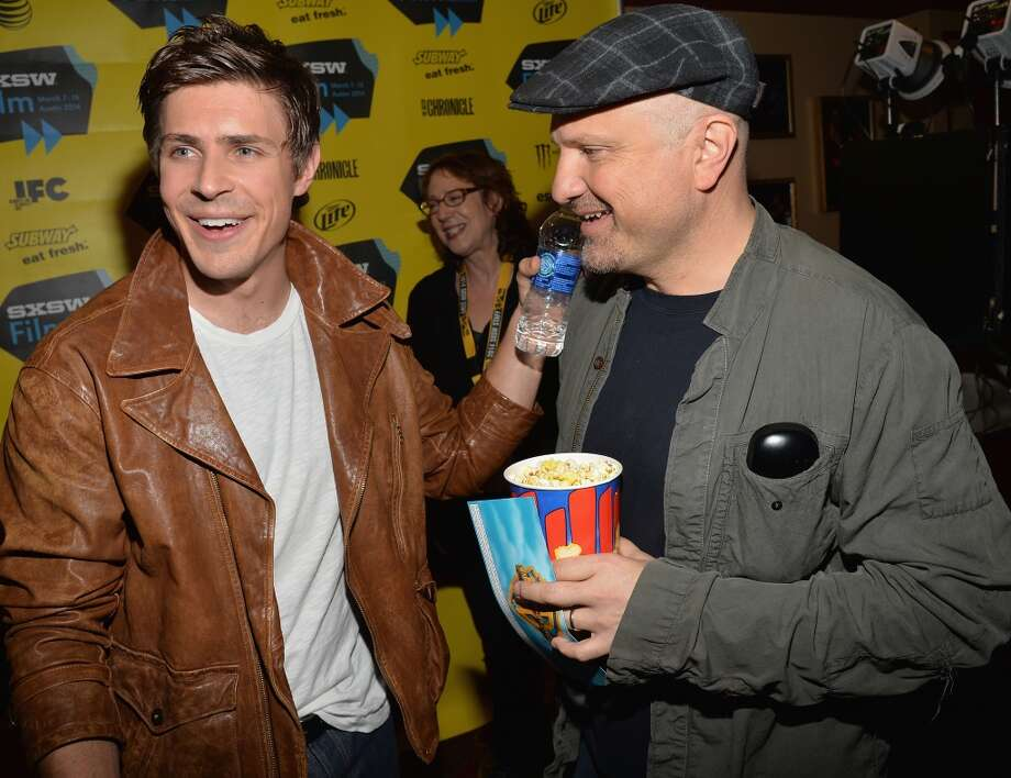 "Actor Chris Lowell (L) and actor Enrico Colantoni arrives at the premiere of ""Veronica Mars"" during the 2014 SXSW Music, Film + Interactive Festival at the Paramount Theatre on March 8, 2014 in Austin, Texas. Photo: Michael Buckner, Getty Images For SXSW"