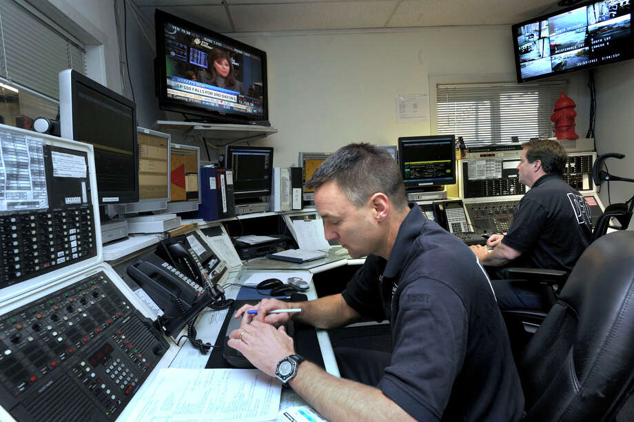 In this file photo, Danbury firefighters Allan Lewis, 44,  left, and Paul Rozzi, 47, staff the dispatch center at the Danbury Fire Department's New Street headquarters. Photo: Carol Kaliff / The News-Times