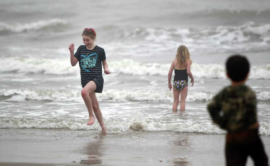 """It's cold!"" screams Rachel Satterlee, 11, as she runs back to dry land while vacation with family for spring break on March 10, 2014, in Galveston. According to the National Weather Service, it's 52 degree at Galveston Island which is 10 degrees cooler then it was last year. Photo: Mayra Beltran, Houston Chronicle / © 2014 Houston Chronicle"