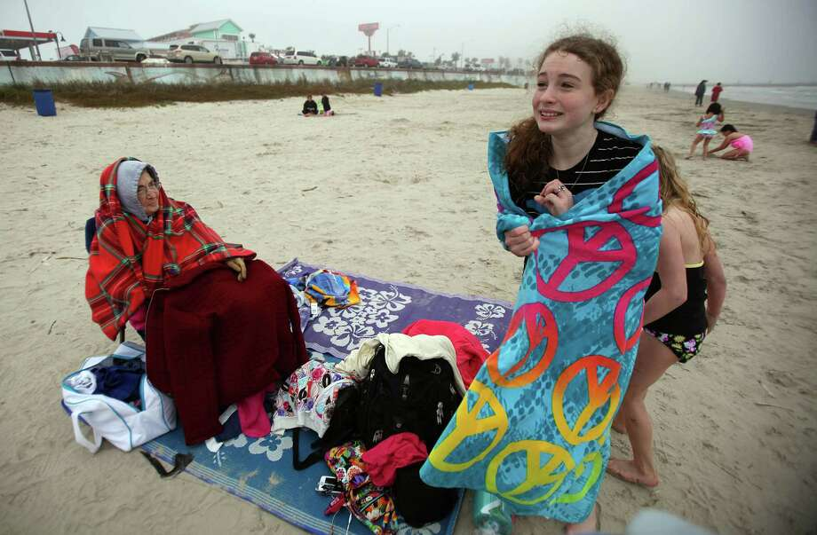 Earline Ischy, 80, stays warm as granddaughter Rachel Satterlee, 11, dries off on a chilly afternoon on the beach during their spring break vacation on March 10, 2014, in Galveston. According to the National Weather Service, it's 52 degree at Galveston Island which is 10 degrees cooler then it was last year. Photo: Mayra Beltran, Houston Chronicle / © 2014 Houston Chronicle