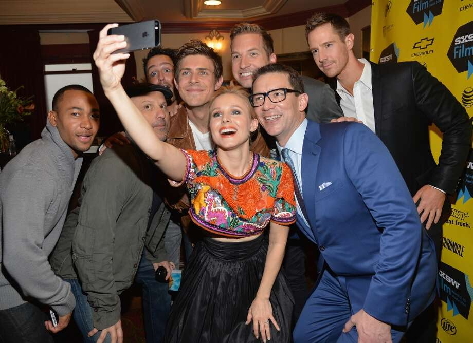 "Actress Kristen Bell (C) poses for a selfie with cast members (L-R) Percy Daggs, Enrico Colantoni, Chris Lowell, Ryan Hansen, Jason Dohring and director Rob Thomas at the premiere of ""Veronica Mars"" during the 2014 SXSW Music, Film + Interactive Festival at the Paramount Theatre on March 8, 2014 in Austin, Texas. Photo: Michael Buckner, Getty Images For SXSW"