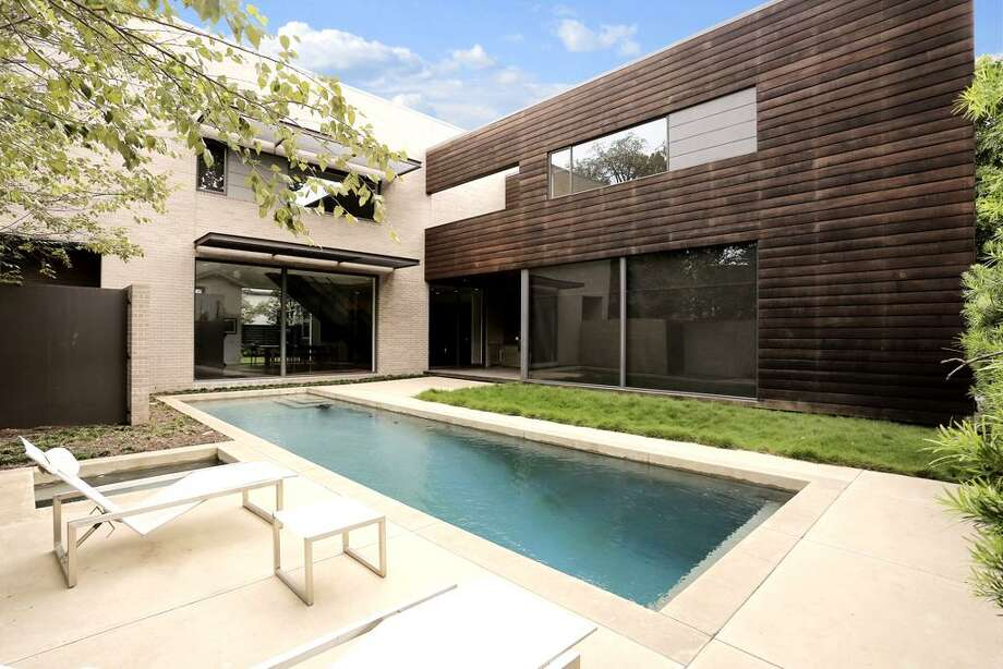 2115 Wroxton: This 2008 modern mega home has 5 bedrooms, 6 full and 2 half bathrooms, 7,694 square feet, and is listed for $3,750,000. Photo: Houston Association Of Realtors