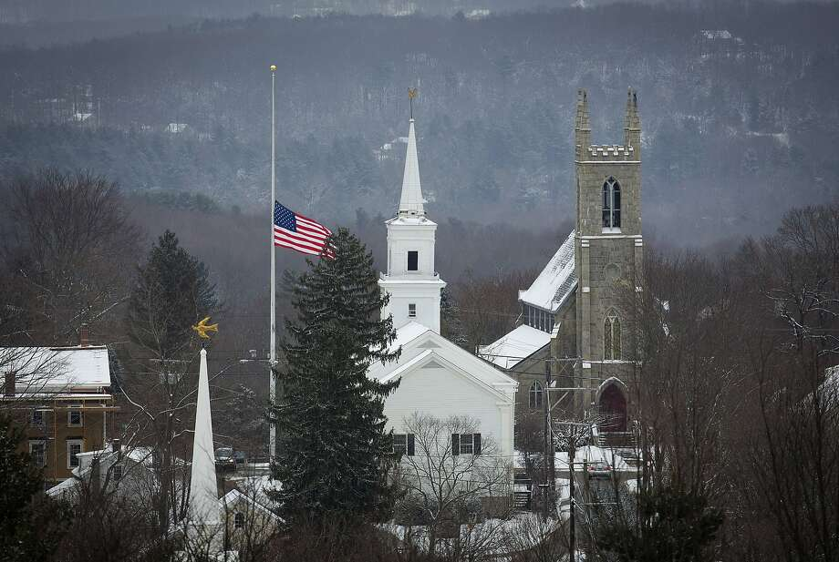 An American flag flies at half-staff in Newtown, Conn., on the anniversary of the 2012 shootings at Sandy Hook Elementary School by Adam Lanza that left 26 people dead. Photo: Carlo Allegri, Reuters