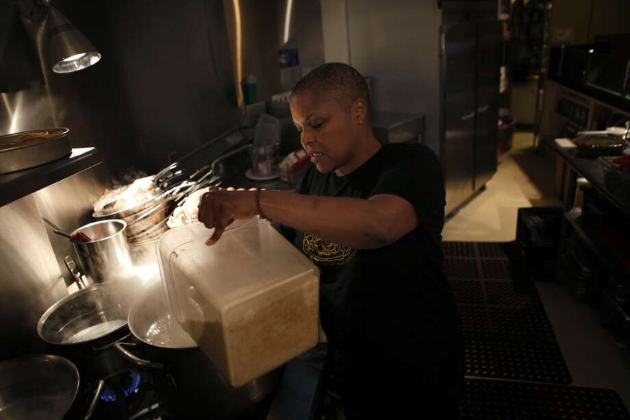 Chef Tanya Holland makes grits in at Brown Sugar Kitchen before it opens  in Oakland, Calif., on Sunday, February 2, 2014. Photo: The Chronicle