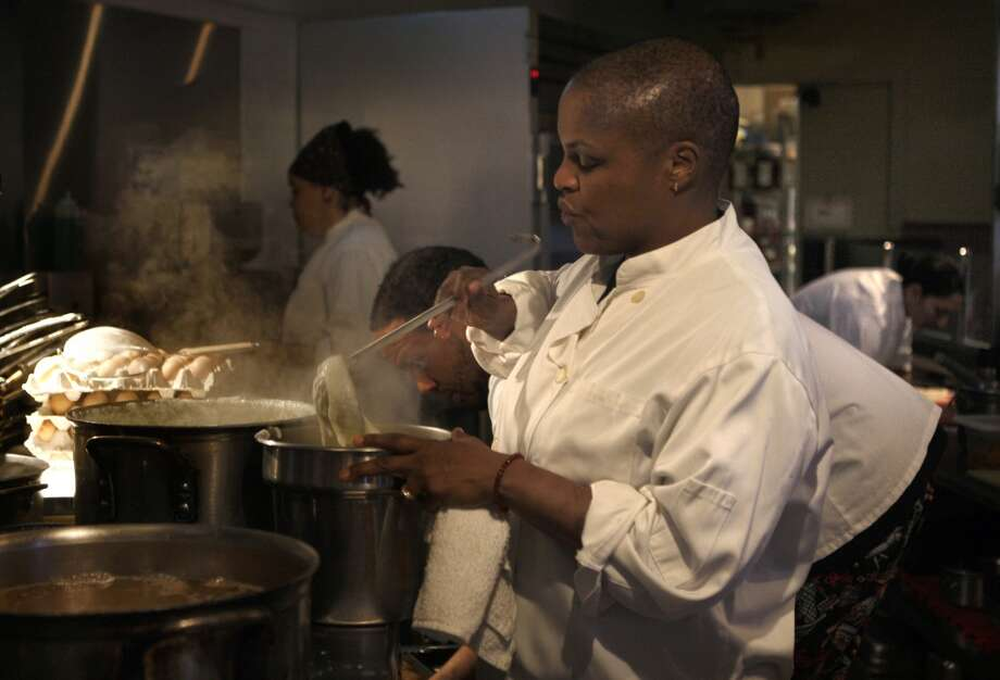 Chef Tanya Holland cooks at Brown Sugar Kitchen in Oakland, Calif., on Sunday, February 2, 2014. Photo: The Chronicle