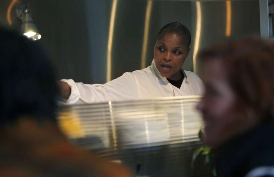 Chef Tanya Holland fills breakfast orders at Brown Sugar Kitchen in Oakland, Calif., on Sunday, February 2, 2014. Photo: The Chronicle